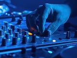 person-adjusting-audio-of-a-sound-mixer-