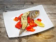 Сибас, запеченный с помидорами Черри и п