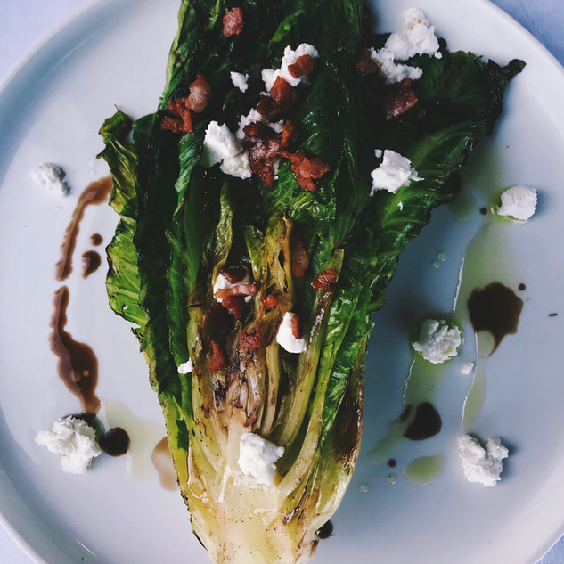 Stella Grilled Romaine with pancetta basil-mint pesto goat cheese