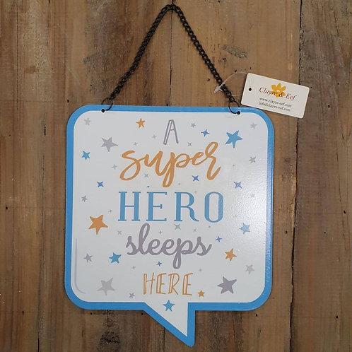 Tekstbord A super hero sleeps here