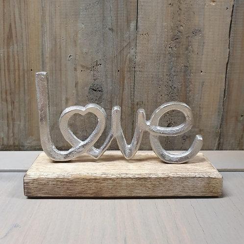 Love op houten voet