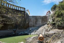 Dam demolished using two hoe rams