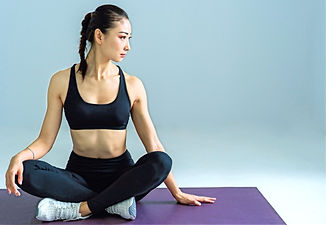 woman-sitting-on-yoga-mat-2294352_edited_edited.jpg