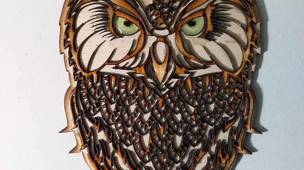 Owl with glowing eyes