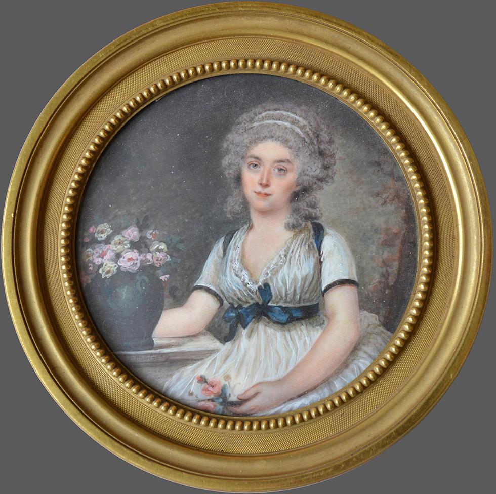 Etienne Motelay, miniature représentant une jeune femme assise près d'un vase de fleurs. Vers 1790 D: 8 cm