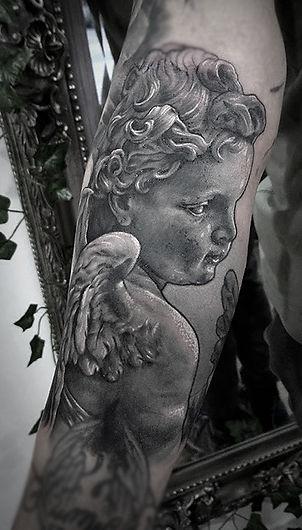 realistic cherub tattoo