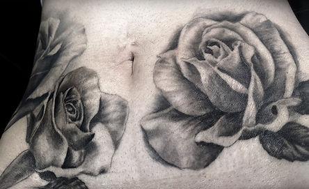 large roses tatoo