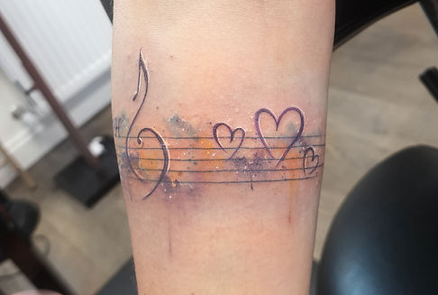 watercolour music notes tattoo