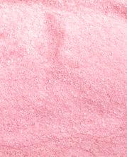ピンクの砂糖のテクスチャ
