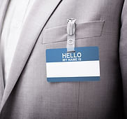 businessman-wearing-hello-my-name-is-tag
