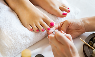 toe nails being painted.png