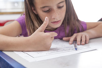 Girl doing the exercise of math.jpg