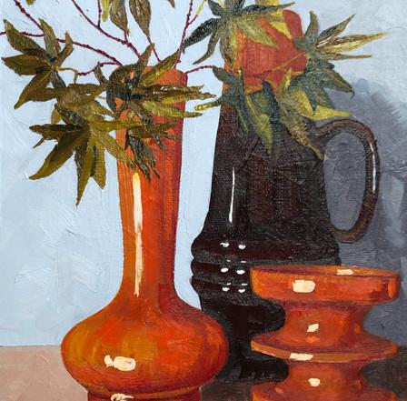 Orange vase with acer