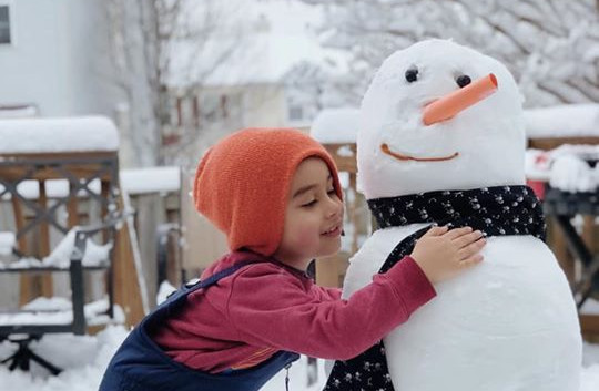 So happy with his snowman
