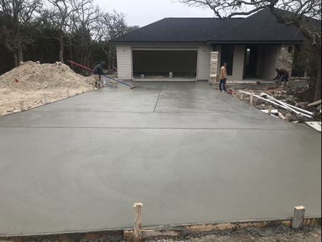 Driveway poured and being finished! Looks nice!