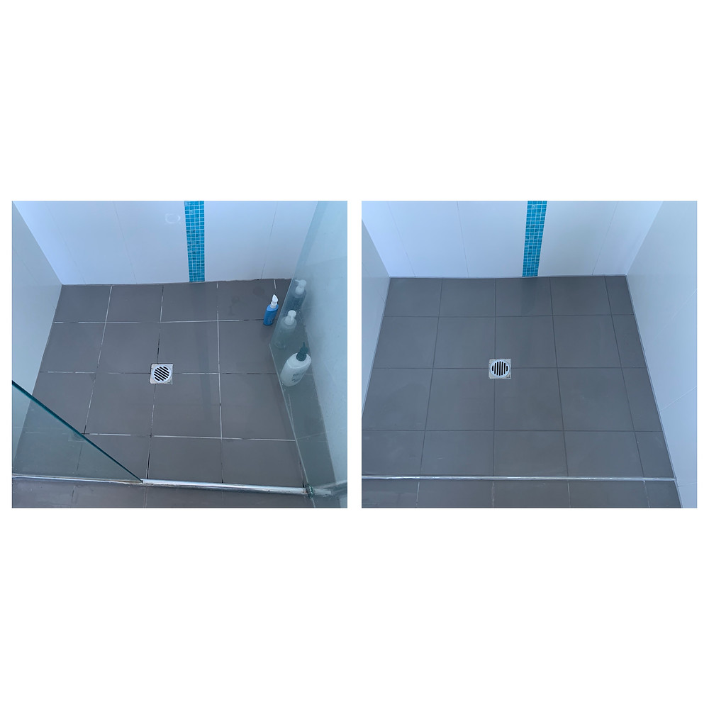 Fresh grout and sealant in white shower with blue feature