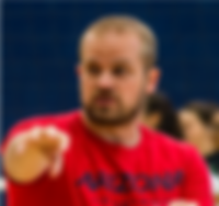 Volleyball Coach Tim Nordensson is pictured mid-game gesturing to his Arizona Wildcats players