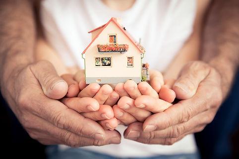 Family of hands holding house.jpg