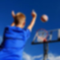 Boy Playing Basketball Game