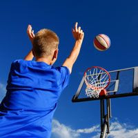 Boy Playing Basketball Game