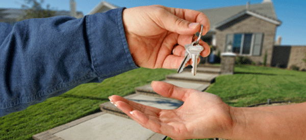 Opposing hands trading house keys, Las Vegas property management
