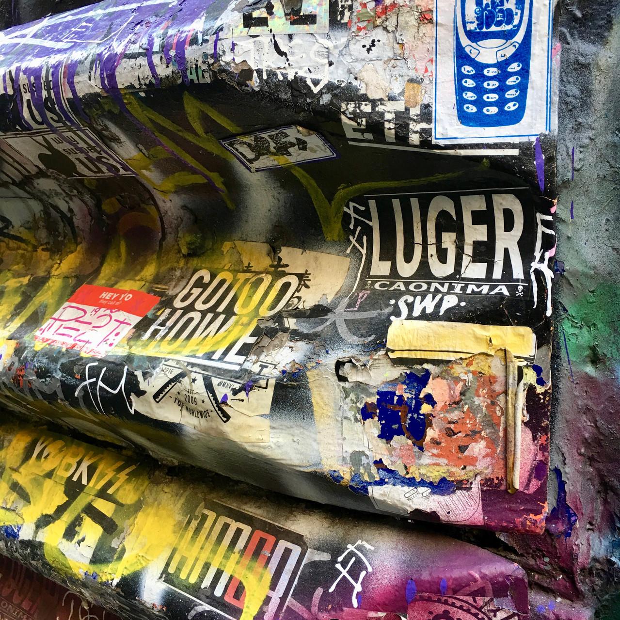Graffiti and stickers on corrugated iron | Union Lane