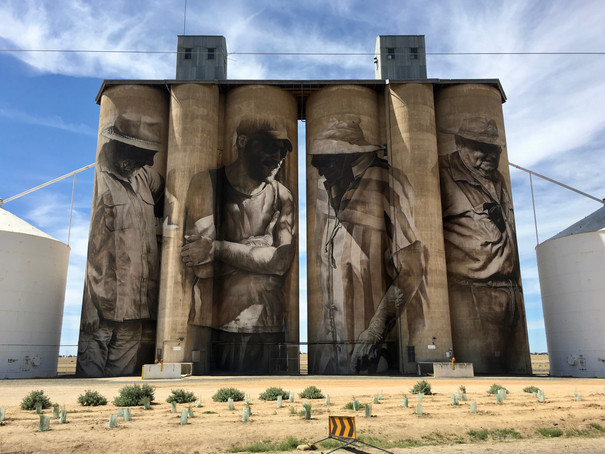 Portraits Painted on Grain Silos near Highway