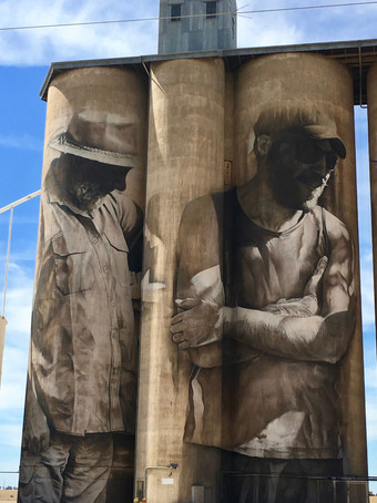 Farm Workers Mural Painted on Tall Grain Silos