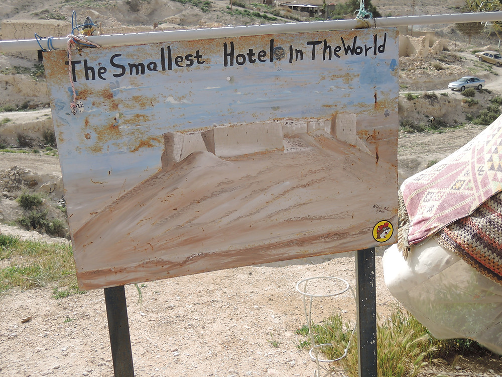 "Hand painted sign declaring ""The Smallest Hotel in the World"