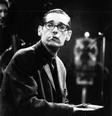 Kind of Blue recording sessions: Bill Evans smoking cigarette while seated at piano