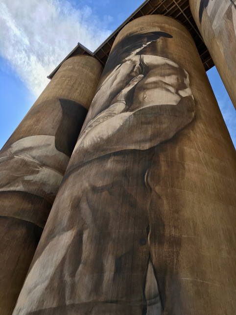 Low Angle View of Portrait on Tall Grain Silo