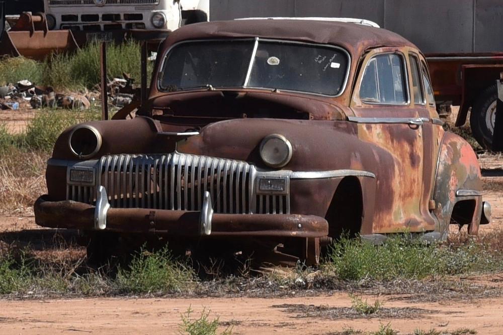 Rusted old sedan