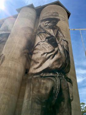 Farmer Painted on Tall Grain Silo