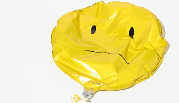Deflated sad face balloon
