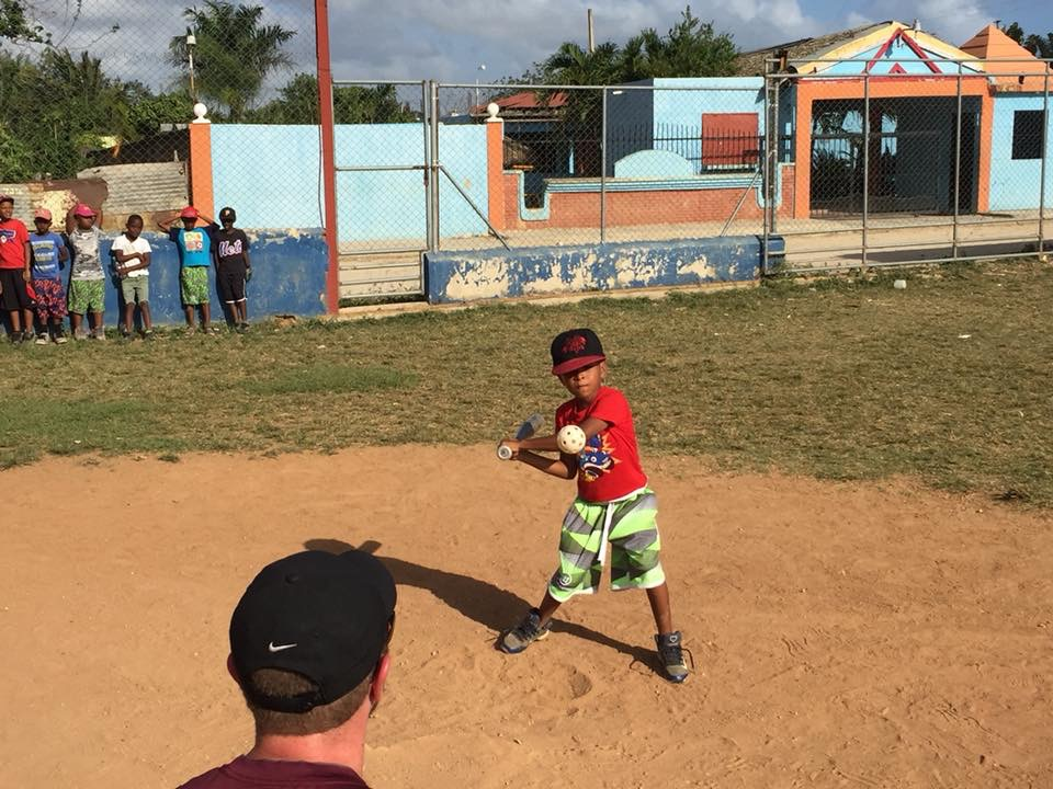 kid practicing baseball