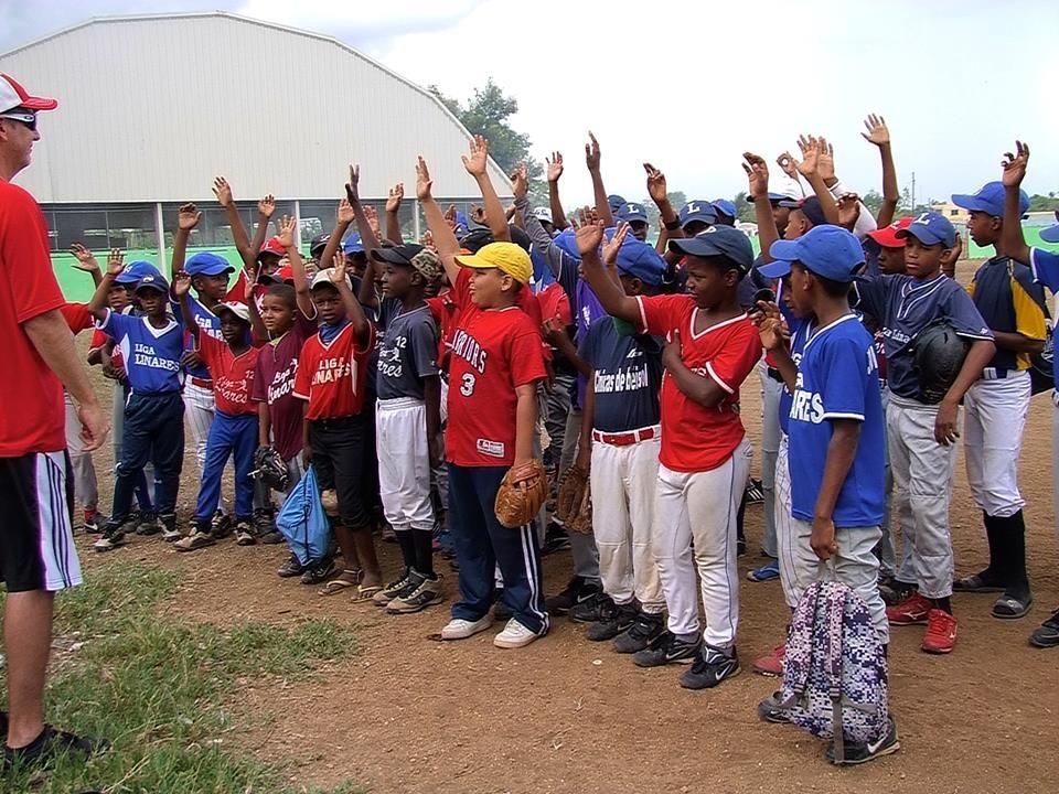 Kids gathering around at a baseball