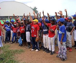 Kids raising their hands at a baseball clinic