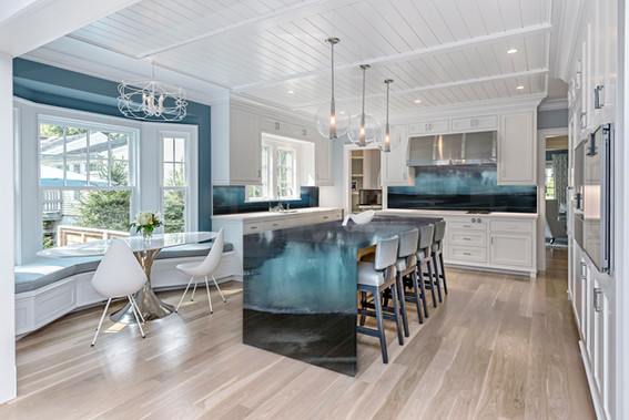 White Kitchen with Island and Back Splash Installation