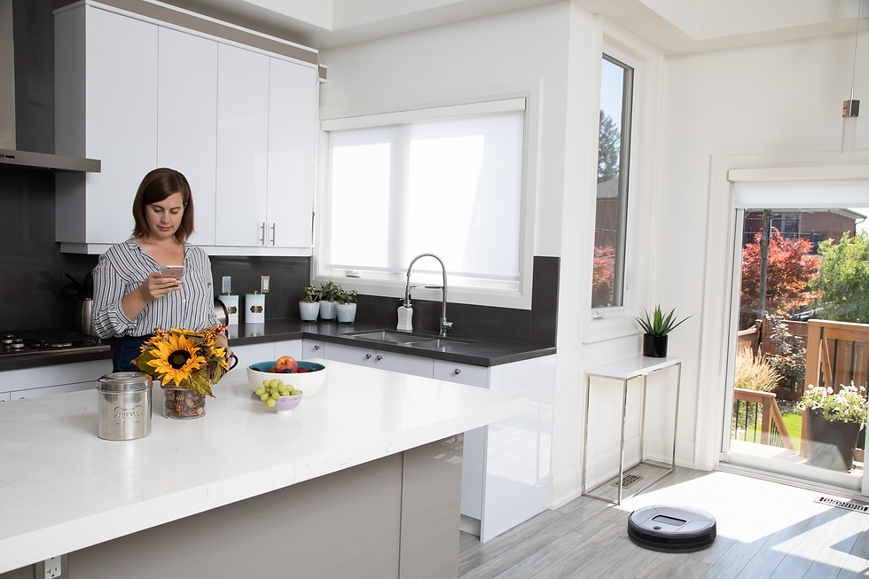 Woman on her phone using the bObsweep app to control her Bob PetHair Vision robot vacuum