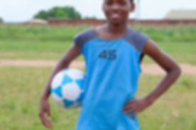 Sports Symbol_ Little Black African Soccer Boy Playing With Ball