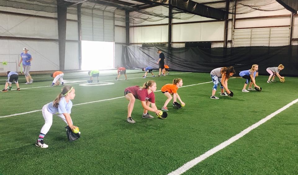 Girls participate in Softball Lesson