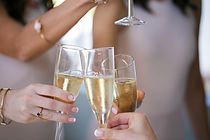 close-up-of-champagne-glasses-being-chim