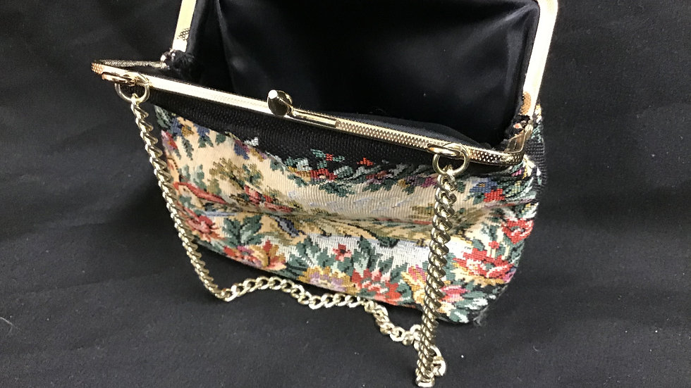 Small purse containing mirror, slip case, mirror, fingernail kit