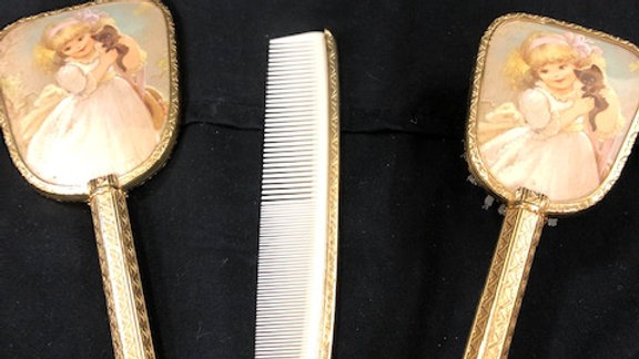 Brush, mirror and comb set as-is.