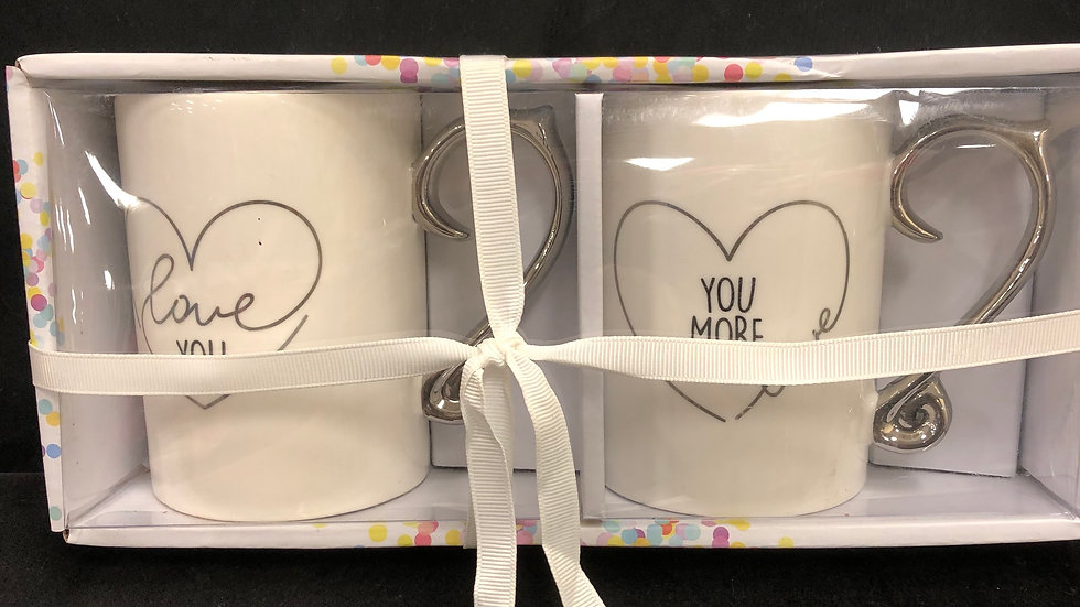 Set of 2 mugs. Chrome handles with sayings on them. Love you/ Love you more.