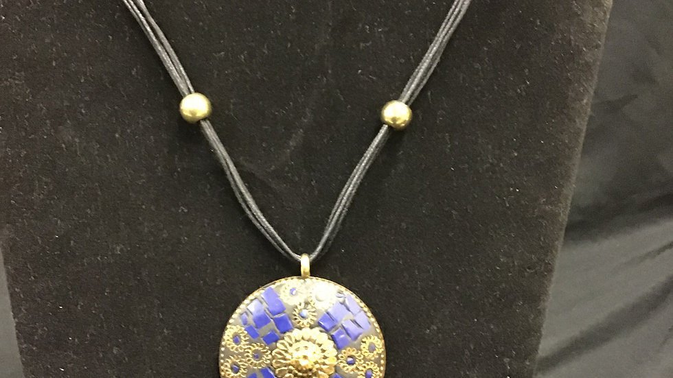 Contemporary dark blue/gold coloured necklace and earrings