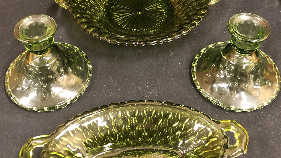 4 pc green coloured glass set. Includes 2 candle holders and 2 dishes