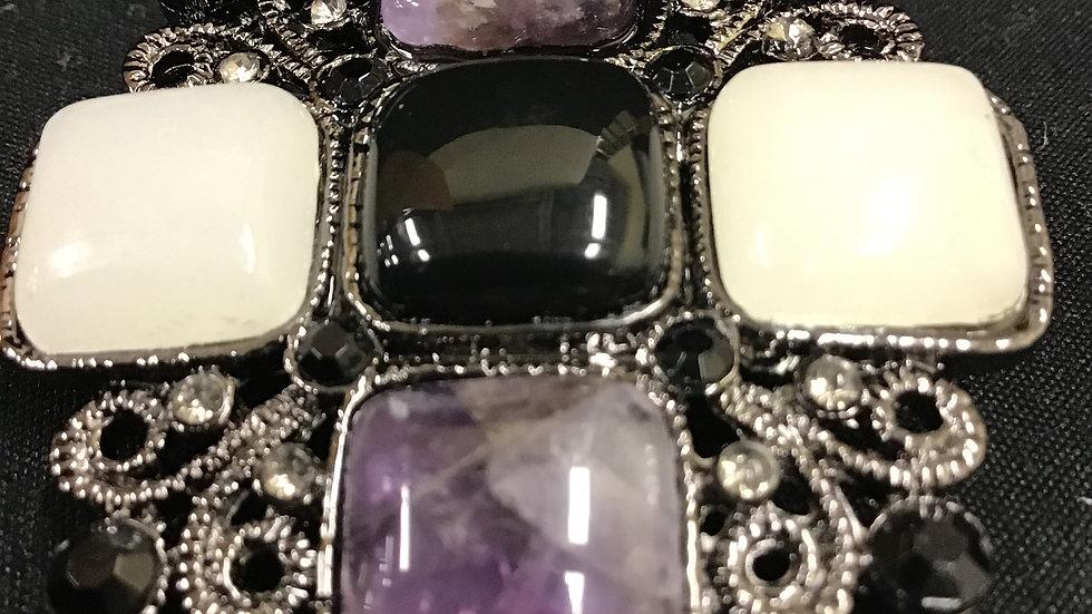 White, purple and black stones set in faux silver/diamonds brooch
