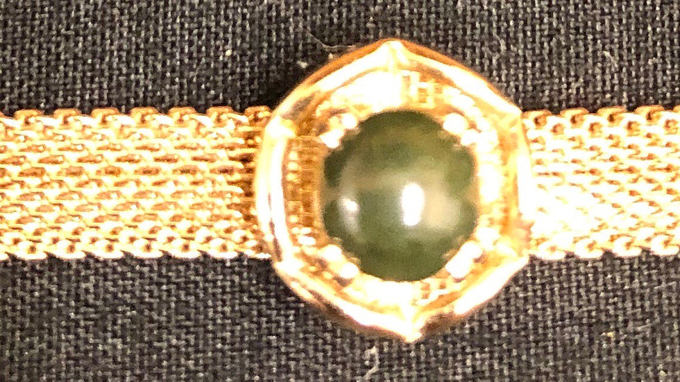 Bracelet with green stone gold coloured band