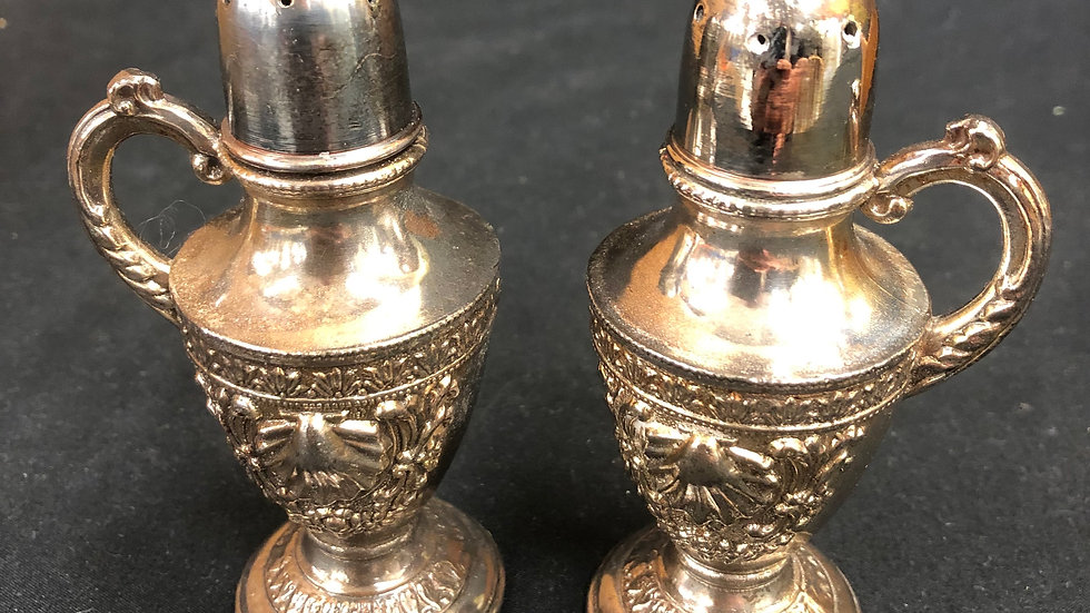 Silver coloured salt and pepper shakers